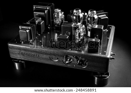 Close up image of hi fi amplifier with thermionic vacuum tubes , with black background - stock photo