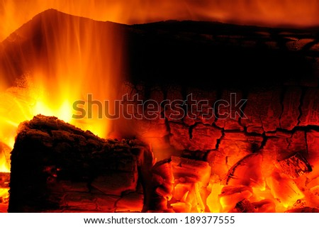 Close up image of hot burning open wood fire, showing flames and coals. - stock photo
