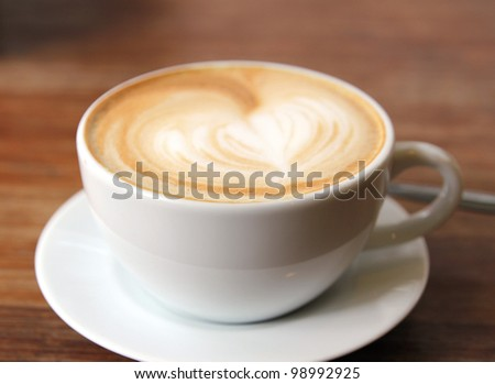 close up image of hot coffee and white cup on table - stock photo