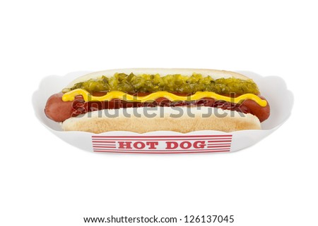 Close up image of hot dog sandwich in paper tray against white background - stock photo