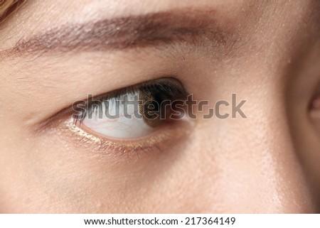 close up image of human eye used fashion contact lens - stock photo
