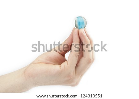 Close up image of human finger with marble ball on top against white background - stock photo