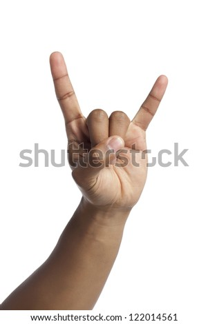 Close up image of human hand gesturing a rock and roll sign against white background - stock photo