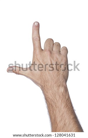 Close-up image of human hand gesturing letter L against the white background - stock photo