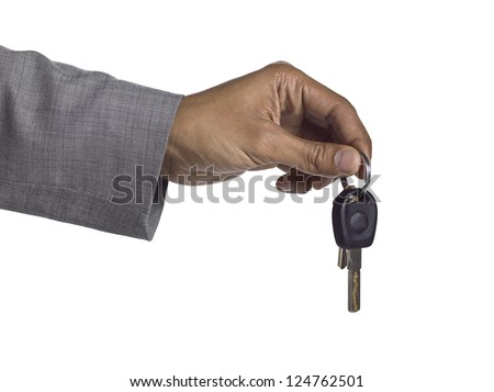 Close up image of human hand holding key against white background