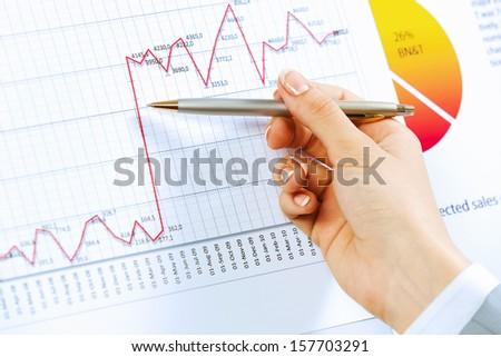 Close up image of human hand holding pencil. Marketing presentation - stock photo