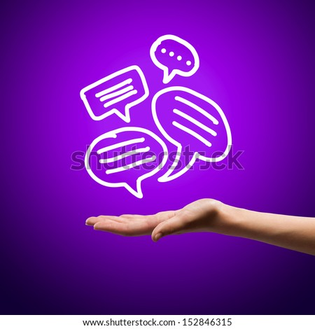 Close up image of human hand holding speech bubbles - stock photo