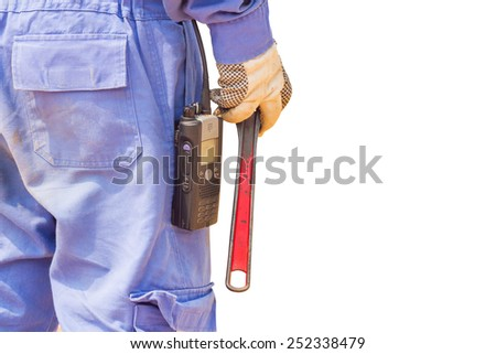 Close-up image of human hand holding wrench - stock photo