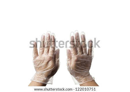 Close-up image of human hand wearing transparent surgical gloves. - stock photo