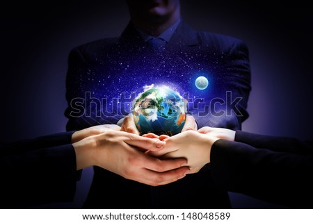 Close up image of human hands holding earth planer. Ecology concept - stock photo