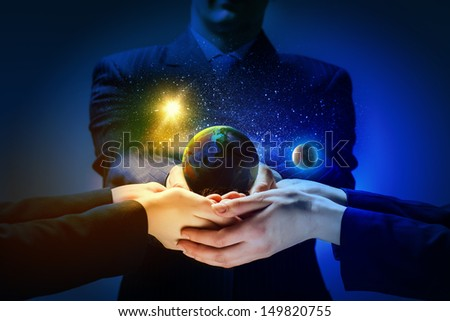 Close up image of human hands holding earth planer. Ecology concept. Elements of this image are furnished by NASA - stock photo