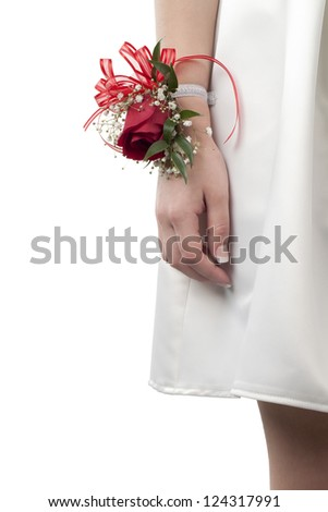 Close-up image of human wrist with prom corsage isolated on a white background - stock photo