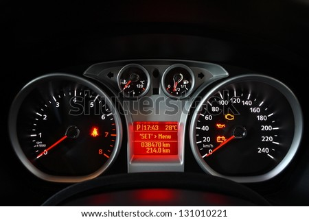 Close up image of illuminated car dashboard - stock photo