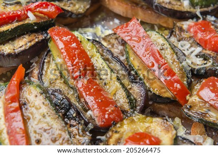 Close-up image of italian bruschetta with courgette, pepper and olive oil