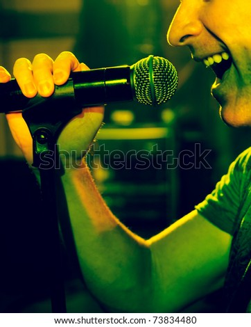 close up image of live singer on stage