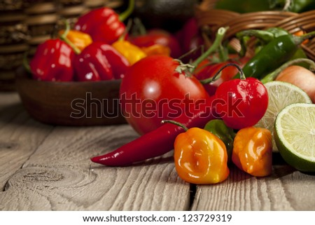 Close up image of mexican vegetables ingredients on wooden table - stock photo