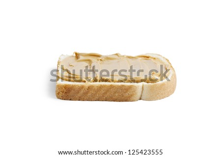 Close up image of peanut butter in bread against white background - stock photo