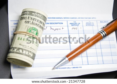 Close up image of pen, checkbook and US dollars, perfect for background - stock photo