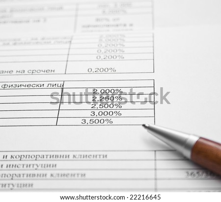 Close up image of pen on financial documentation