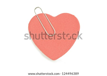 Close-up image of pink heart paper with a paper clip - stock photo
