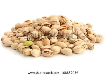 Close-up image of pistachios studio isolated on white background - stock photo