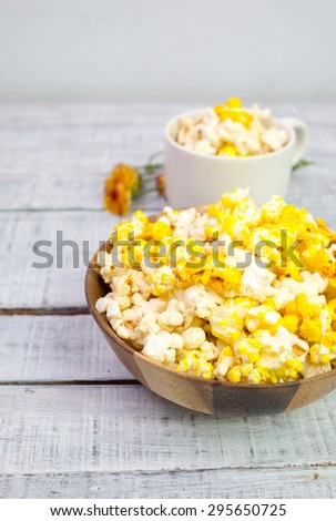 Close up image of pop corn in wooden bowl - stock photo