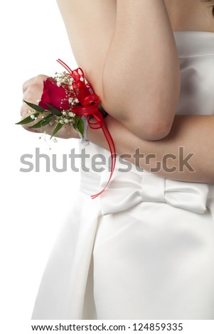 Close-up image of red rose corsage on the female's wrist isolated on a white background - stock photo