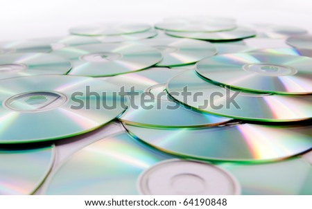 close up image of several cd and dvd isolated in white - stock photo