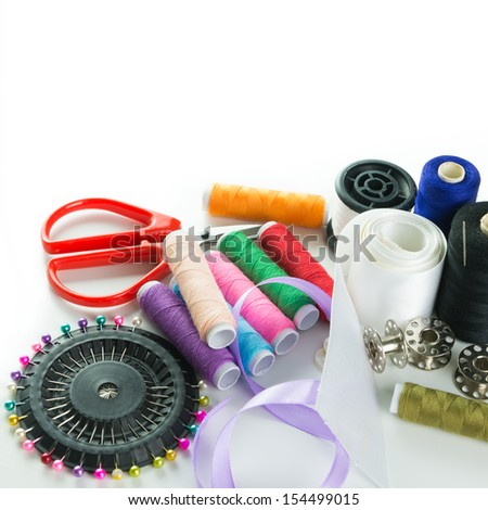 Close-up image of sewing stuff over white background - stock photo