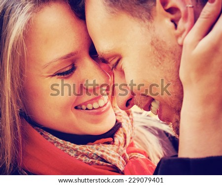Close-up image of smiling couple in love, concept of love and happiness - stock photo
