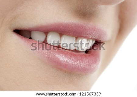 Close up image of smiling female lips against white background