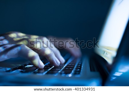 Close-up image of software engineer typing on laptop - stock photo