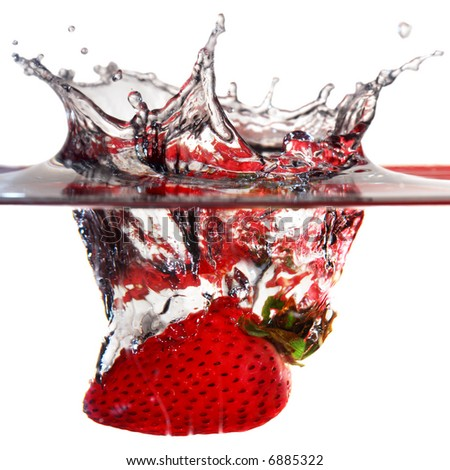 Close-up image of strawberry dropped to water - stock photo