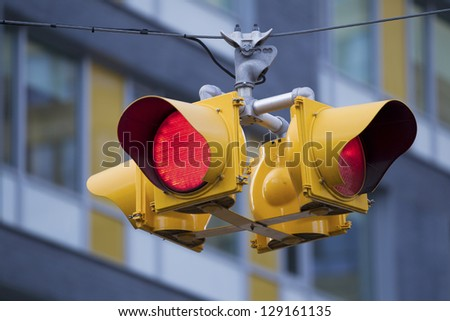 Close-up image of street signal with building on the background. - stock photo