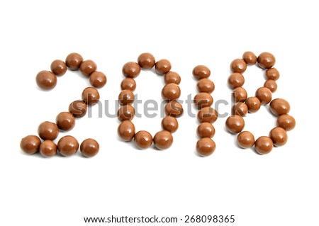 Close-up image 2018 of sweet chocolate round on a white background. Slightly defocused and close-up shot.