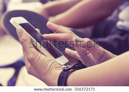 Close up image of Teenage girl text messaging on her phone