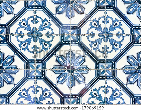 Close up image of the beautifully decorated tiles on the houses in the streets of Lisbon, Portugal - stock photo