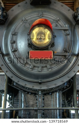 Close up image of the front light of an antique steam engine in the Train Museum in Salisbury North Carolina. - stock photo