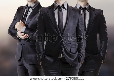 Close up image of three business men in black suit - stock photo
