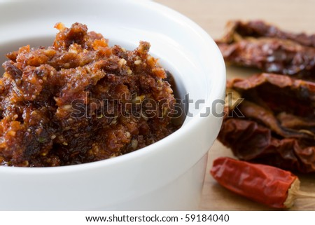 Close-up image of tomato pesto made from dried tomatoes, chillies, parmesan cheese, garlic and pine nuts