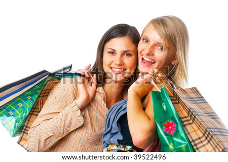 Close-up image of two happy shoppers with parcels on white background - stock photo