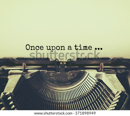 close up image of typewriter with paper sheet and the phrase: once upon a time . copy space for your text. retro filtered  - stock photo