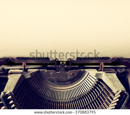close up image of typewriter with paper sheet. copy space for your text. retro filtered  - stock photo