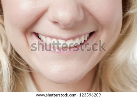 Close up image of woman's with  toothy smile - stock photo