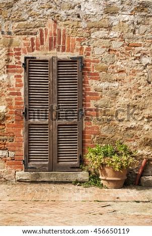 Close-up Image of Wooden Ancient Italian Door - stock photo