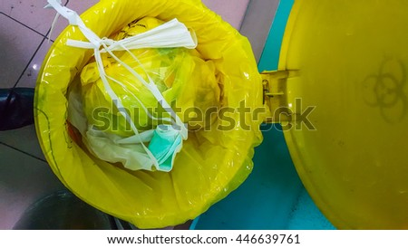 Close up image of yellow bin for hazardous waste in hospital.  - stock photo