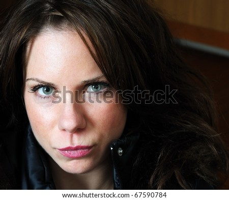 Close up image of young beautiful caucasian female with black jacket - stock photo