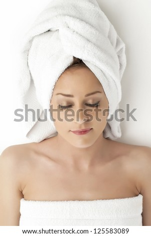 Close-up image of young lady relaxing on the spa