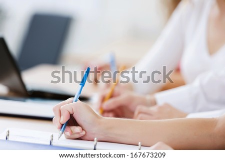 Close up image of young people using laptop at classroom - stock photo
