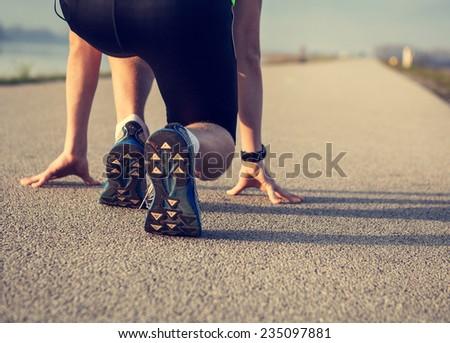 Close up image sprinter legs on the start  - stock photo
